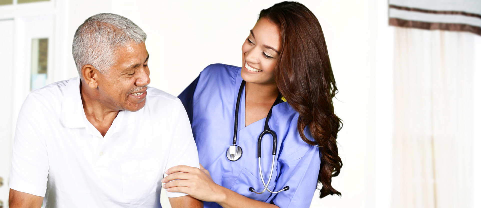 nursing assistant assisting elderly man