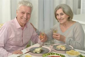 2 senior citizen eating